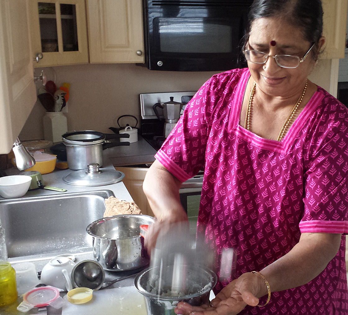 Indian mom cooking in kitchen