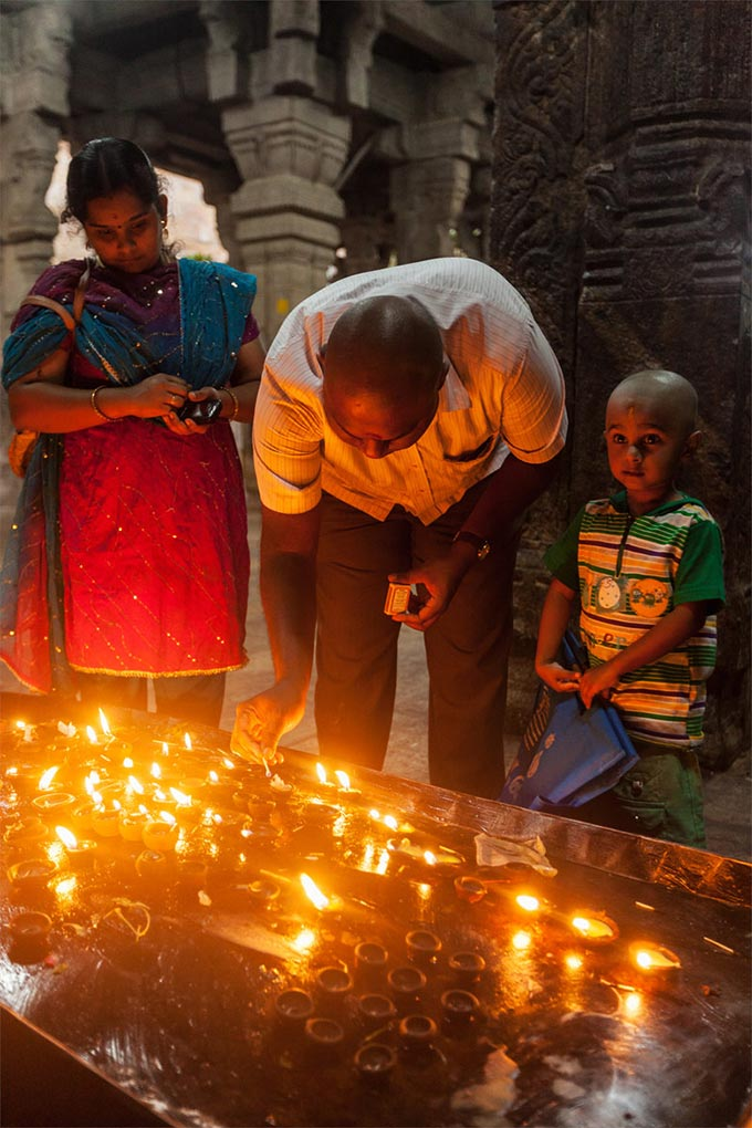 worshipping ghee candles at a Hindu temple