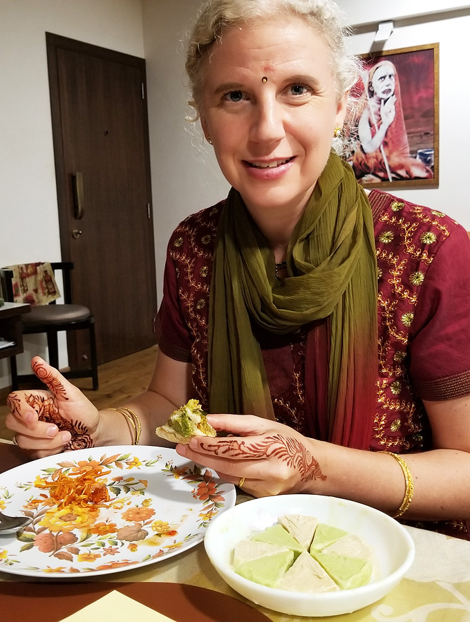 Westerner eating home-cooked Indian food in Mumbai, India.