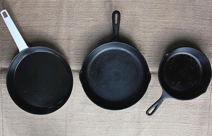 Three different cast iron skillets