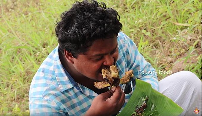 A man eats brinjal