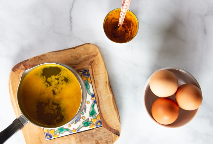 A pot with Turmeric for turmeric Poached Eggs