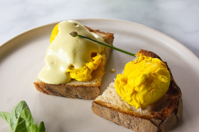 Turmeric Poached Eggs on toast with Vegan Hollandaise