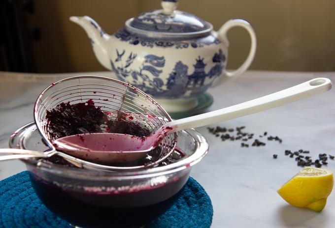 blueberries strained through a sieve
